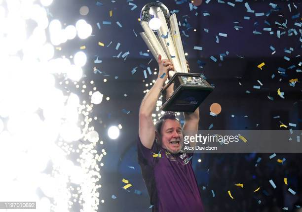 Peter Wright lifts the Sid Waddell William Hill World Darts Championship Trophy after victory in the Final of the 2020 William Hill World Darts...