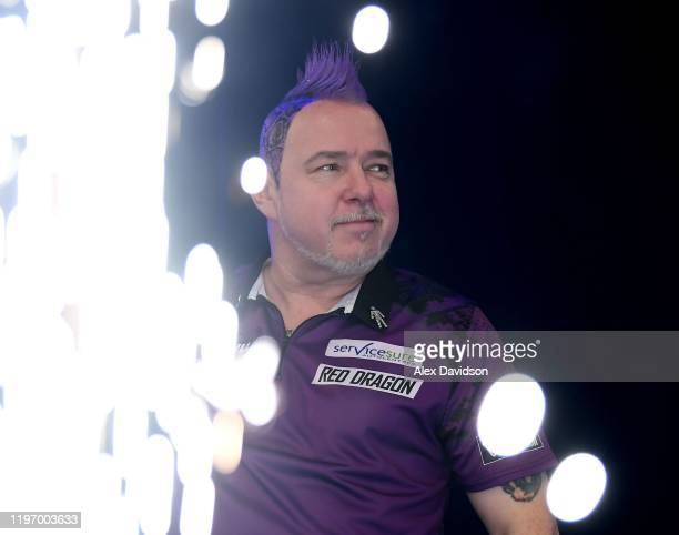 Peter Wright looks on during the Final of the 2020 William Hill World Darts Championship between Peter Wright and Michael Van Gerwen at Alexandra...