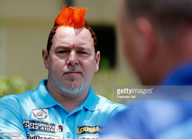 Peter Wright of England are pictured after the draw ceremony for the Dubai Duty Free Darts Masters to reveal the Quarter Final matches at Dubai Duty...