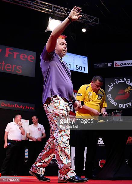 Peter Wright of England celebrates after defeating Dave Chisnall of England during the 2014 Dubai Duty Free Darts Masters SemiFinal match at Dubai...