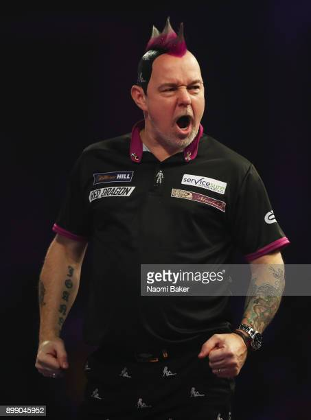 Peter Wright of England celebrates after winning a leg during his second round match against Jamie Lewis of Wales on day eleven of the 2018 William...