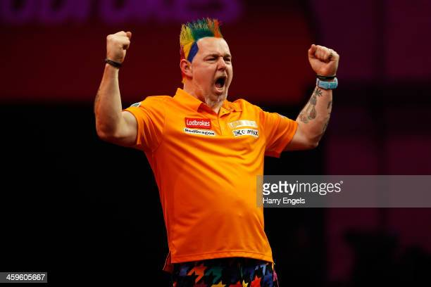Peter Wright of England celebrates victory during his quarter final match against Wes Newton of England on day thirteen of the Ladbrokescom World...