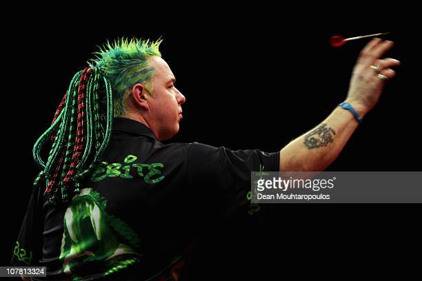 Peter Wright of England in action against Phil 'The Power' Taylor of England during day 11 in the 2011 Ladbrokescom World Darts Championship at...