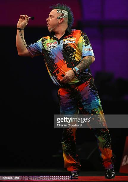 Peter Wright of England in action during his first round match against Joe Cullen of England during the Ladbrokescom World Darts Championship on Day...