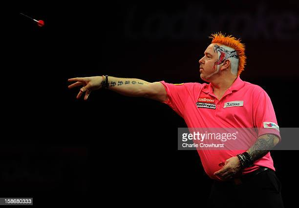 Peter Wright of England in action during his second round match against Michael van Gerwen of the Netherlands on day Ten of the Ladbrokescom World...