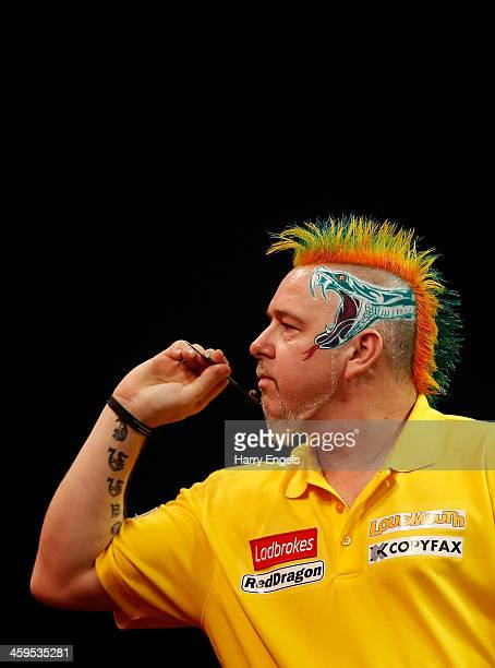 Peter Wright of England in action during his third round match against Michael Smith of England on day twelve of the Ladbrokescom World Darts...