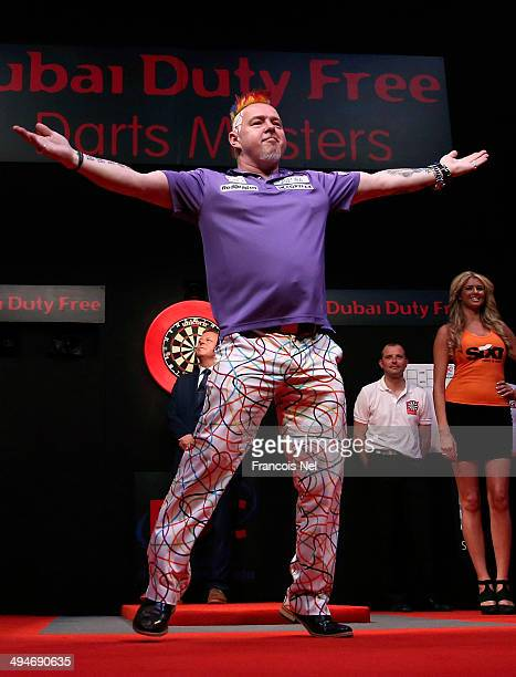 Peter Wright of England makes his entrance prior to the start of 2014 Dubai Duty Free Darts Masters SemiFinal match against Dave Chisnall at Dubai...
