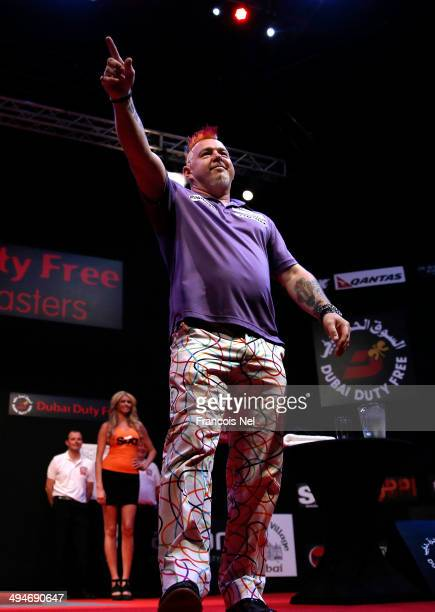 Peter Wright of England makes his entrance prior to the start of 2014 Dubai Duty Free Darts Masters Semi-Final match against Dave Chisnall at Dubai...