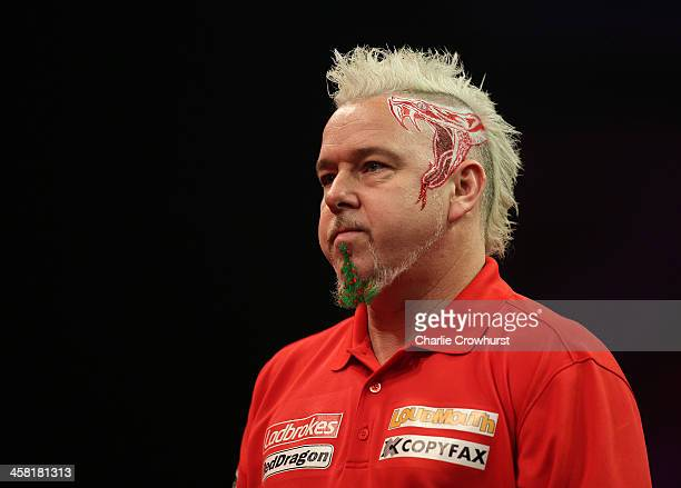 Peter Wright of England nick named 'Snake Bite' sports a festive beard desgin during his second round match against Per Laursen of Denmark during the...