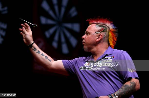 Peter Wright of England plays against Dave Chisnall of England during the 2014 Dubai Duty Free Darts Masters SemiFinal match at Dubai Duty Free...