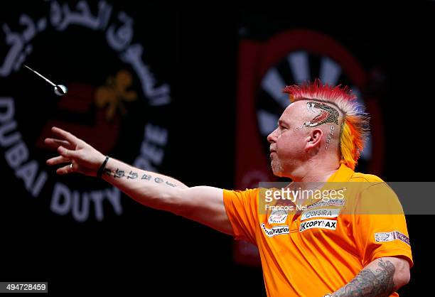 Peter Wright of England plays against Michael Van Gerwen of the Netherlands during the 2014 Dubai Duty Free Darts Masters Final match at Dubai Duty...