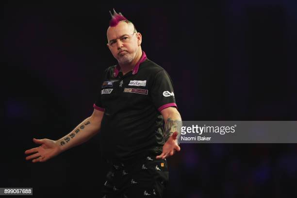 Peter Wright of England reacts during his second round match against Jamie Lewis of Wales on day eleven of the 2018 William Hill PDC World Darts...