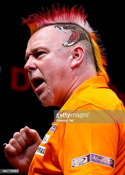 Peter Wright of England reacts during the 2014 Dubai Duty Free Darts Masters Final match at Dubai Duty Free Tennis Stadium Irish Village on May 30...