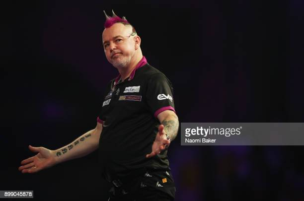 Peter Wright of England shows disapointment during his second round match against Jamie Lewis of Wales on day eleven of the 2018 William Hill PDC...