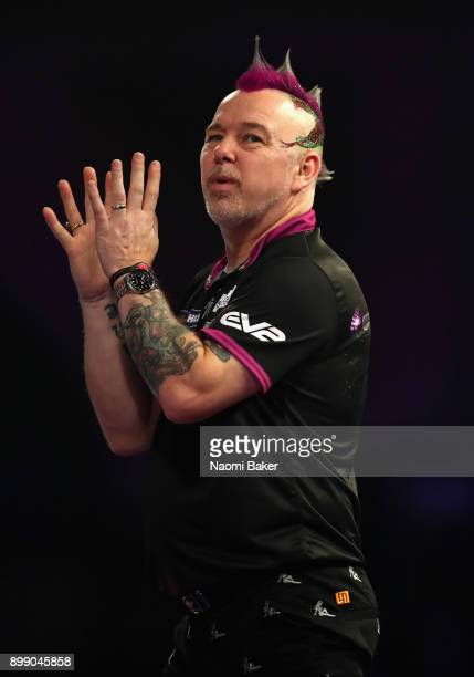 Peter Wright of England shows frustration during his second round match against Jamie Lewis of Wales on day eleven of the 2018 William Hill PDC World...