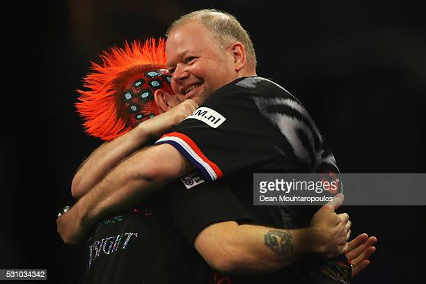 Peter Wright of Scotland and Raymond van Barneveld of the Netherlands embrace prior to the Darts Betway Premier League Night 15 at Rotterdam Ahoy on...