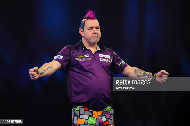 Peter Wright of Scotland celebrates after winning his Fourth Round match against Jeffrey de Zwaan of The Netherlands during Day Thirteen of the 2020...