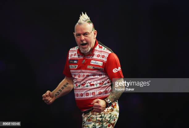 Peter Wright of Scotland celebrates after winning his match against Diogo Portela of Brazil on day eight of the 2018 William Hill PDC World Darts...