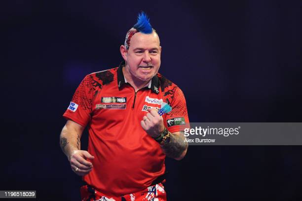 Peter Wright of Scotland celebrates after winning his QuarterFinal match against Luke Humphries of England during Day Fourteen of the 2020 William...