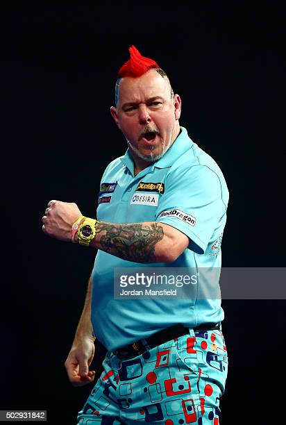Peter Wright of Scotland celebrates in his third round match against Dave Chisnall of England on Day Twelve of the 2016 William Hill PDC World Darts...