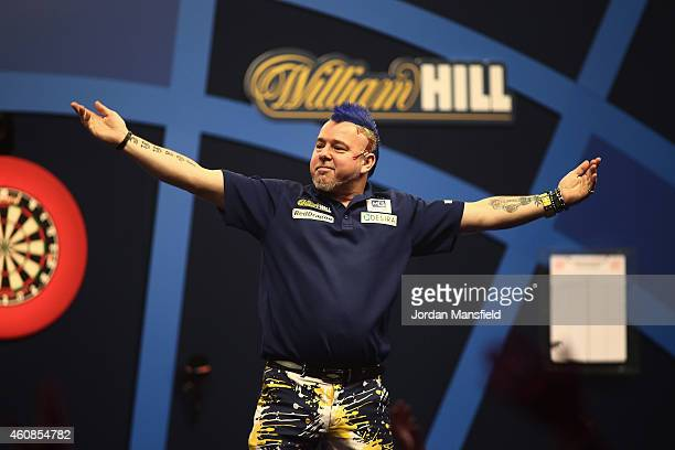 Peter Wright of Scotland celebrates winning his second round match against Ronny Huybrechts of Belgium during Day Seven of the William Hill PDC World...