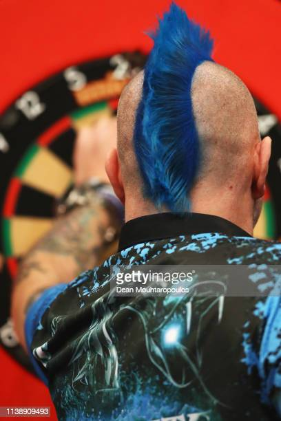 Peter Wright of Scotland competes against Gerwyn Price of Wales during day one of the 2019 Unibet Premier League Darts on March 28 2019 at the Ahoy...