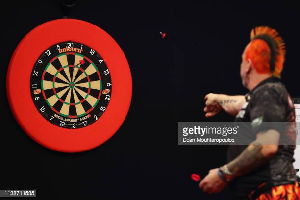 Peter Wright of Scotland competes against Michael van Gerwen of the Netherlands during day one of the 2019 Unibet Premier League Darts on March 27...