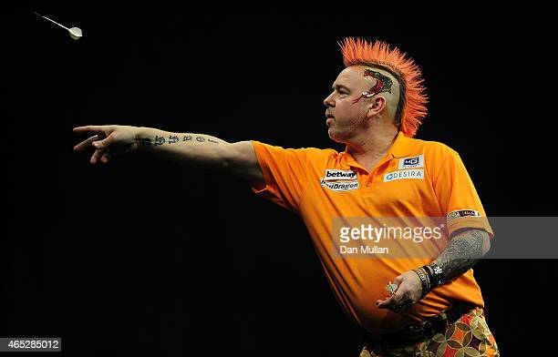 Peter Wright of Scotland competes against Michael van Gerwen of Holland during The Betway Premier League Darts at Westpoint Arena on March 5 2015 in...