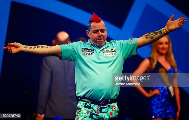 Peter Wright of Scotland dances as he walks on stage ahead of his third round match against Dave Chisnall of England on Day Twelve of the 2016...
