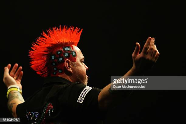 Peter Wright of Scotland dances for the fans before he plays against Raymond van Barneveld of the Netherlands during the Darts Betway Premier League...