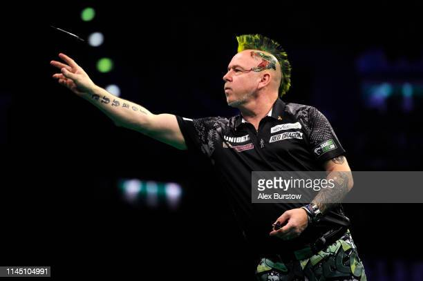 Peter Wright of Scotland in action against Daryl Gurney of Northern Ireland during the 2019 Unibet Premier League Darts at Arena Birmingham on April...