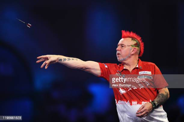 Peter Wright of Scotland in action against Seigo Asada of Japan in his Third Round match during Day Eleven of the 2020 William Hill World Darts...