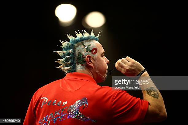 Peter Wright of Scotland in action during his first round match against Gerwyn Price of Wales on Day Two of the William Hill PDC World Darts...