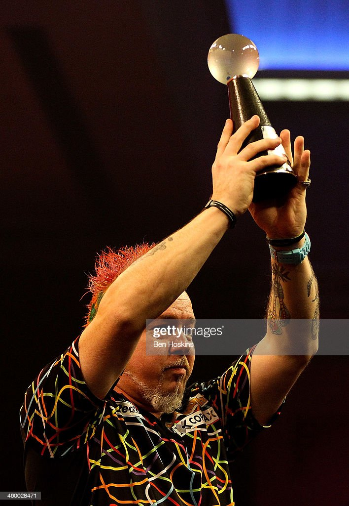 Peter Wright of Scotland lifts his runners up trophy after losing to Michael van Gerwen of The Netherlands in the final of the Ladbrokes.com World Darts Championships at Alexandra Palace on January 1, 2014 in London, England.