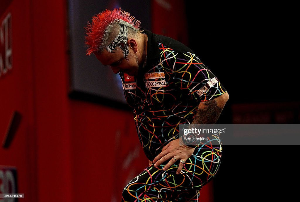 Peter Wright of Scotland looks dejected during the final of the Ladbrokes.com World Darts Championships at Alexandra Palace on January 1, 2014 in London, England.