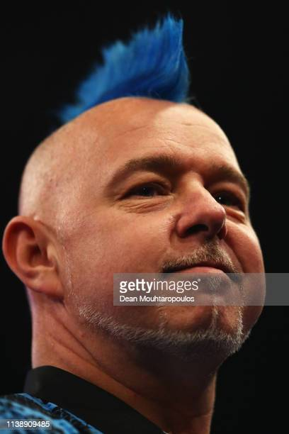 Peter Wright of Scotland looks on as he competes against Gerwyn Price of Wales during day one of the 2019 Unibet Premier League Darts on March 28...