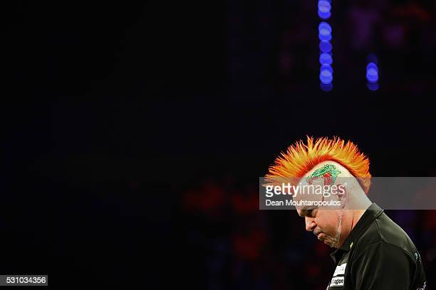 Peter Wright of Scotland looks on as he plays Raymond van Barneveld of the Netherlands during the Darts Betway Premier League Night 15 at Rotterdam...