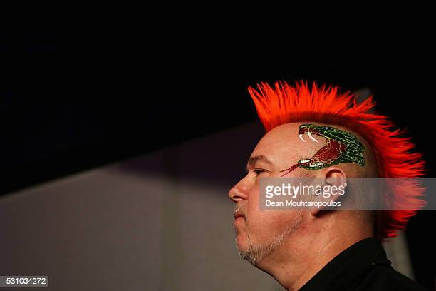 Peter Wright of Scotland looks on before he plays a shot in his match against Raymond van Barneveld of the Netherlands during the Darts Betway...