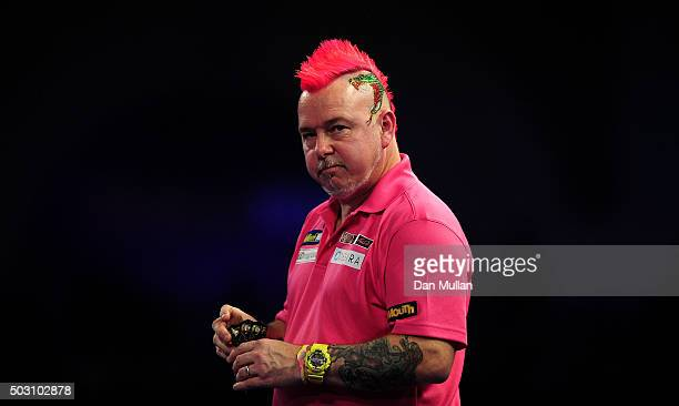 Peter Wright of Scotland looks on during his quarter final match against Adrian Lewis of England during Day Thirteen of the 2016 William Hill PDC...