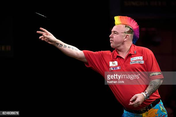 Peter Wright of Scotland plays a shot in his semifinal match against Michael van Gerwen of the Netherlands during the SINGHA Beer Grand Slam of Darts...