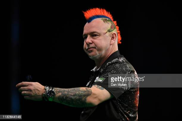 Peter Wright of Scotland reacts against Mensur Suljovic of Austria during the 2019 Unibet Premier League Darts at Westpoint Arena on February 28 2019...