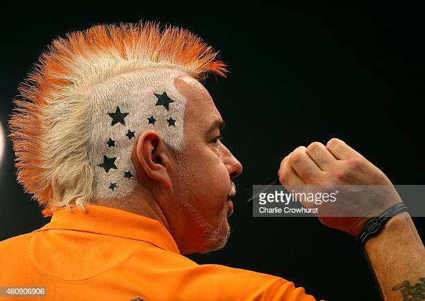 Peter Wright of Scotland shows off his hair style during his third round match against Andy Hamilton of England during the William Hill PDC World...