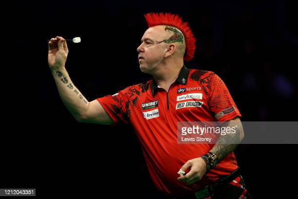 Peter Wright of Scotlandthrows a dart in his match against Michael Smith of England during Night Six of the Premier League Darts at the M&S Bank...