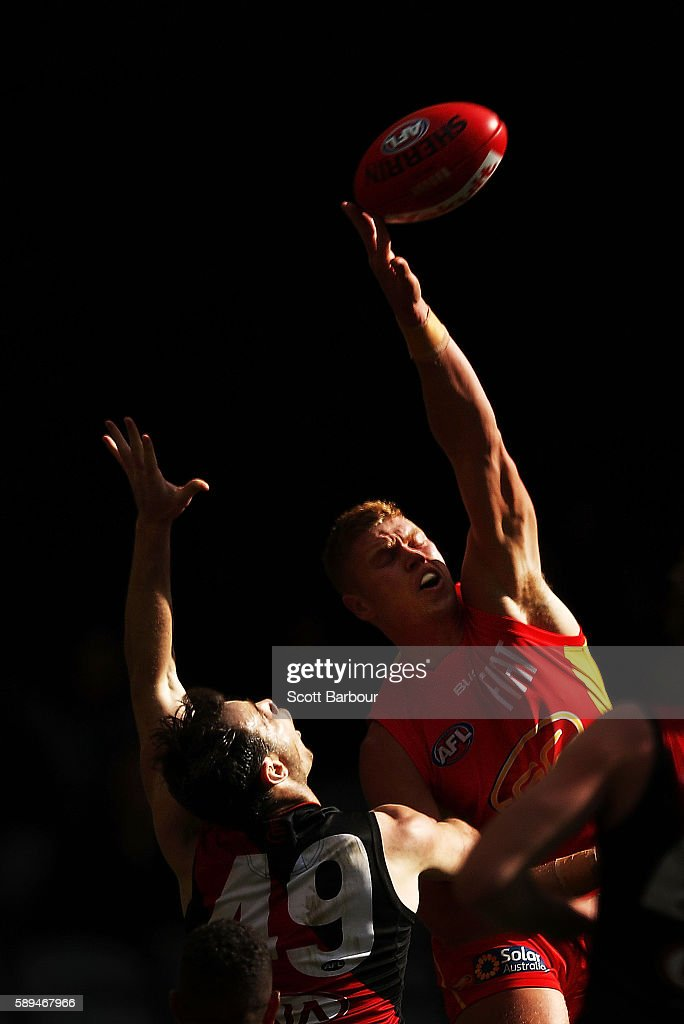 Peter Wright of the Suns and Matt Dea of the Bombers compete for the ball during the round 21 AFL match between the Essendon Bombers and the Gold Coast Titans at Etihad Stadium on August 14, 2016 in Melbourne, Australia.