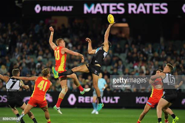 Peter Wright of the Suns and Patrick Ryder of the Power compete for the ruck contest during the round 23 AFL match between the Port Adelaide Power...