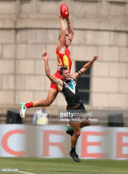Peter Wright of the Suns attempts to mark over Brad Ebert of the Power during the 2017 AFL round 08 match between the Gold Coast Suns and Port...