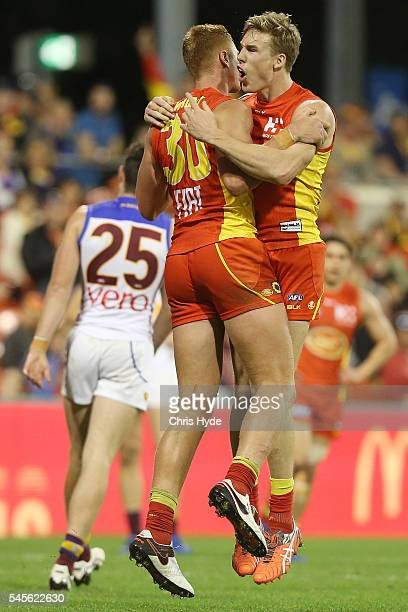 Peter Wright of the Suns celebrates a goal with team mate Tom Lynch during the round 16 AFL match between the Gold Coast Suns and the Brisbane Lions...