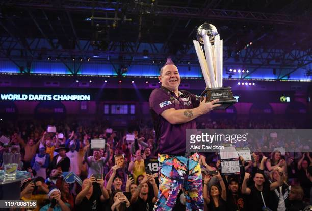 Peter Wright poses with the Sid Waddell William Hill World Darts Championship Trophy after victory in the Final of the 2020 William Hill World Darts...