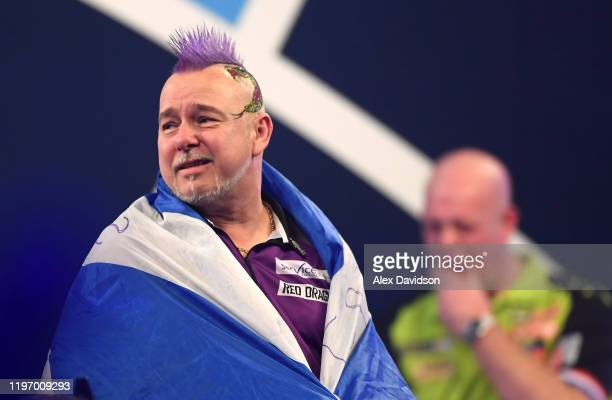 Peter Wright reacts after victory in the Final of the 2020 William Hill World Darts Championship between Peter Wright and Michael van Gerwen at...