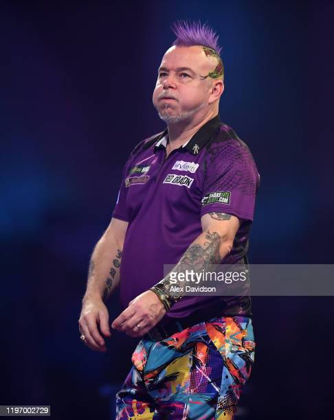 Peter Wright reacts during the Final of the 2020 William Hill World Darts Championship between Peter Wright and Michael Van Gerwen at Alexandra...